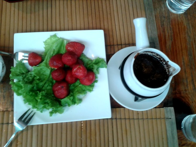 Strawberries served with melted chocolate.