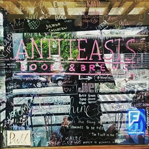 Antiteasis' glass door transformed into a freedom wall (photo from google.com)
